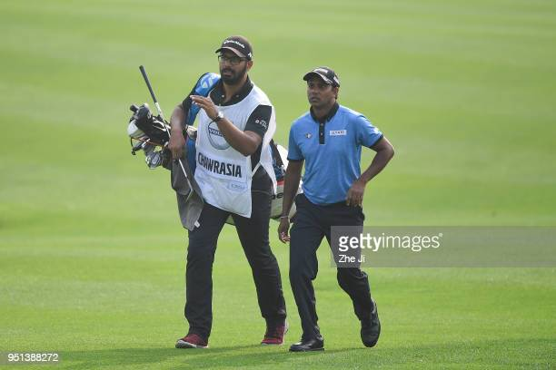 P Chawrasia of India walks with his caddie on the 12th hole during the first round of the 2018 Volvo China Open at Topwin Golf and Country Club on...
