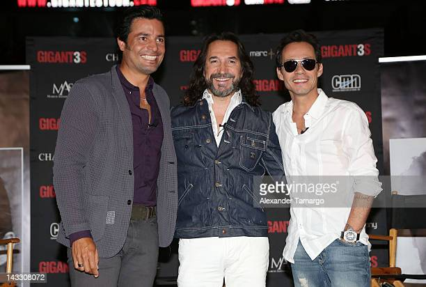 Chayanne Marco Antonio Solis and Marc Anthony attend a press conference to announce their tour at American Airlines Arena on April 23 2012 in Miami...
