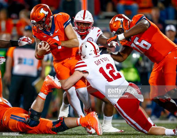 Chayce Crouch of the Illinois Fighting Illini runs the ball against the Nebraska Cornhuskers tries to make the stop from behind at Memorial Stadium...
