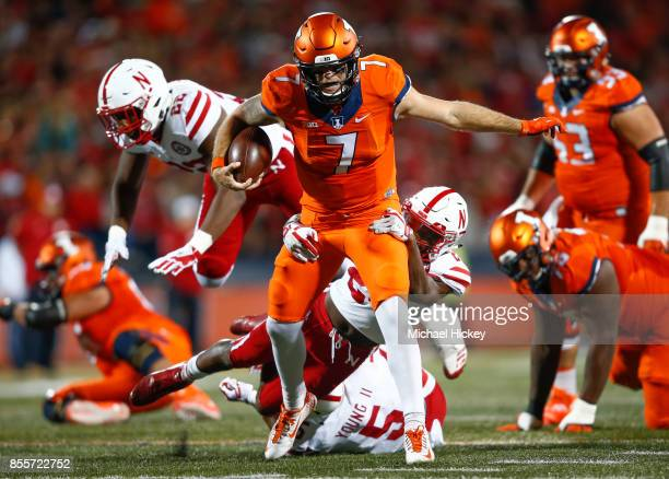 Chayce Crouch of the Illinois Fighting Illini runs the ball as Aaron Williams of the Nebraska Cornhuskers makes the tackle from behind at Memorial...