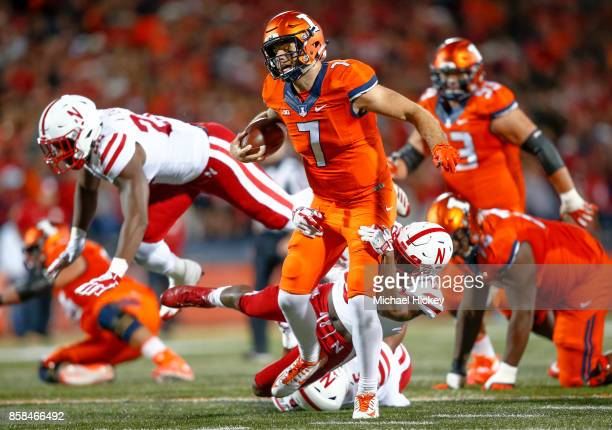 Chayce Crouch of the Illinois Fighting Illini runs the ball as Dedrick Young II of the Nebraska Cornhuskers tries to make the stop from behind at...