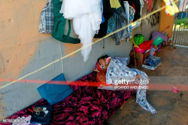 Chayniska Marie Incarnation sleeps on a cot in her grandmother house garage in Vieques Puerto Rico on November 26 2017 / AFP PHOTO / Ricardo ARDUENGO...