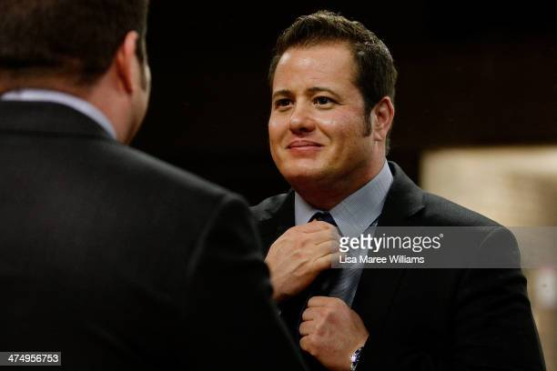 Chaz Bono adjusts his tie in a mirror prior to appearing on stage as part of the 2014 Sydney Gay Lesbian Mardi Gras at the Seymour Centre on February...