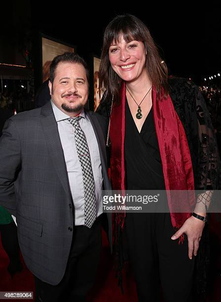 Chaz Bono and Rebecca Root attend the premiere Of Focus Features' The Danish Girl on November 21 2015 in Westwood California