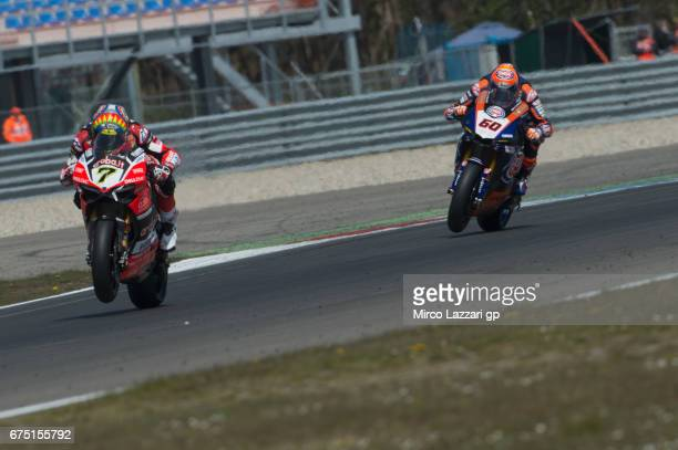 Chaz Davies of Great Britain and ARUBAIT RACINGDUCATI leads Michael Van Der Mark of Netherlands and PATA Yamaha Official WorldSBK Team during the...