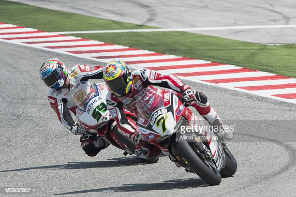 Chaz Davies of Great Britain and Ducati Superbike Team leads Niccol Canepa of Italy and Althea Racing during the FIM Superbike World Championship...