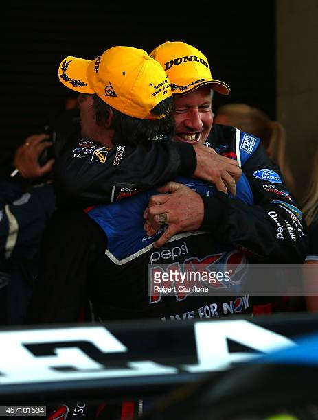 Chaz Mostert driver of the Pepsi Max Crew Ford celebrates with co driver Paul Morris after they combined to win the Bathurst 1000 which is round 11...