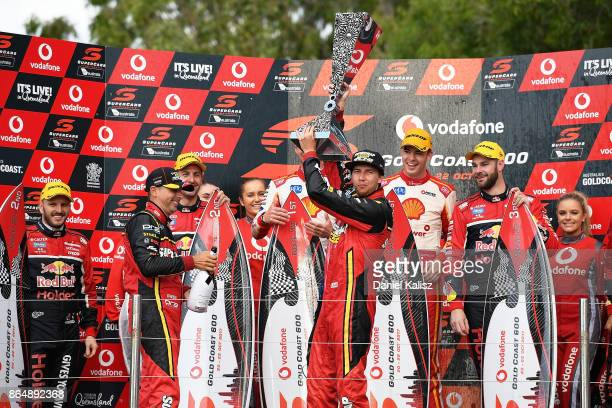 Chaz Mostert driver of the Supercheap Auto Racing Ford Falcon FGX celebrates on the podium after race 22 for the Gold Coast 600 which is part of the...