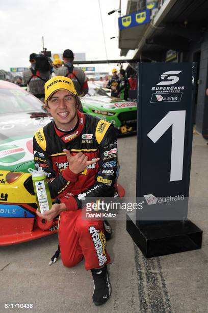 Chaz Mostert driver of the Supercheap Auto Racing Ford Falcon FGX celebrates after winning race 6 for the Phillip Island 500 which is part of the...