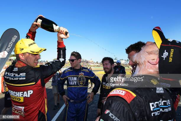 Chaz Mostert driver of the Supercheap Auto Racing Ford Falcon FGX celebrates after winning during race 16 for the Ipswich SuperSprint which is part...