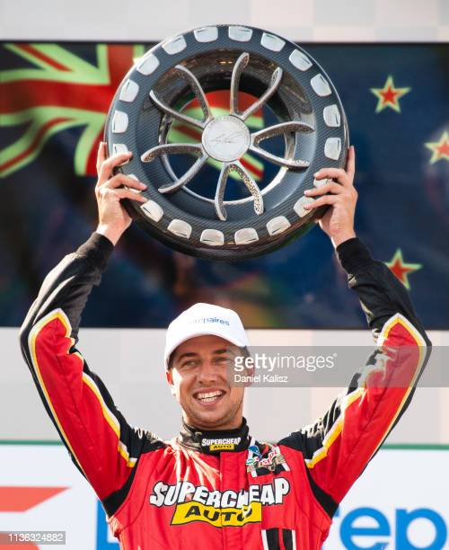 Chaz Mostert driver of the Supercheap Auto Racing Ford Mustang celebrates on the podium during race 4 for the Melbourne 400 Supercars Championship...