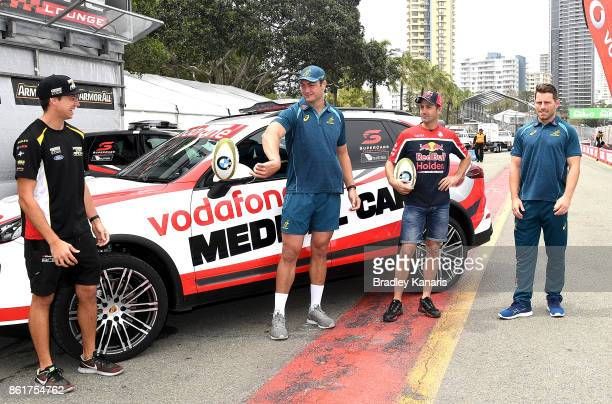 Chaz Mostert Rob Simmons Jamie Whincup and Bernard Foley pass the footy around during an Australian Wallabies media opportunity in Pit Lane ahead of...