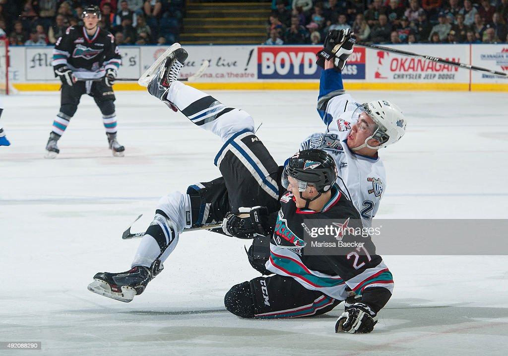 Chaz Reddekopp #29 of Victoria Royals collides with Calvin Thurkauf #27 of Kelowna Rockets of Kelowna Rockets on OCTOBER 9, 2015 at Prospera Place in Kelowna, British Columbia, Canada.