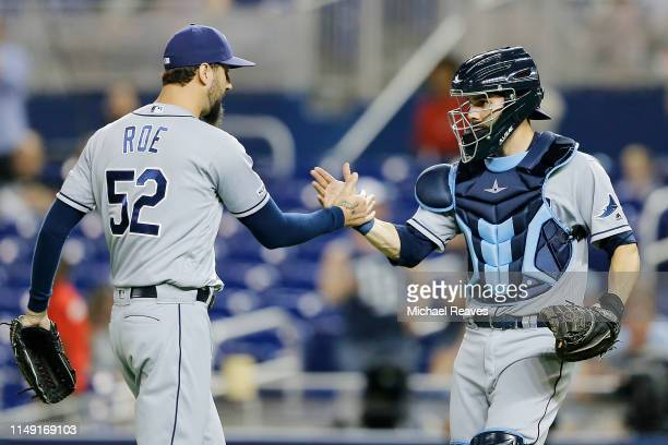 Chaz Roe of the Tampa Bay Rays celebrates with Anthony Bemboom after a win over the Miami Marlins 40 at Marlins Park on May 14 2019 in Miami Florida