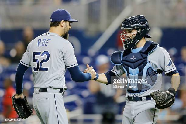 Chaz Roe of the Tampa Bay Rays celebrates with Anthony Bemboom after they defeated the Miami Marlins 40 at Marlins Park on May 14 2019 in Miami...
