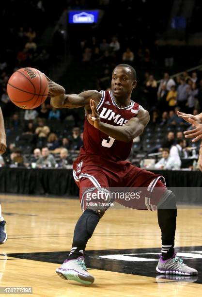Chaz Williams of the Massachusetts Minutemen passes in the second half against the George Washington Colonials during the Quarterfinals of the 2014...