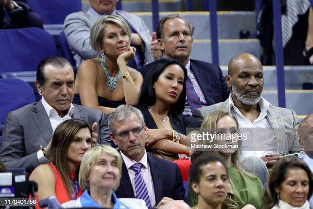 Chazz Palminteri, Lakiha Spicer and Mike Tyson attends the Women's Singles first round match between Maria Sharapova of Russia and Serena Williams of...