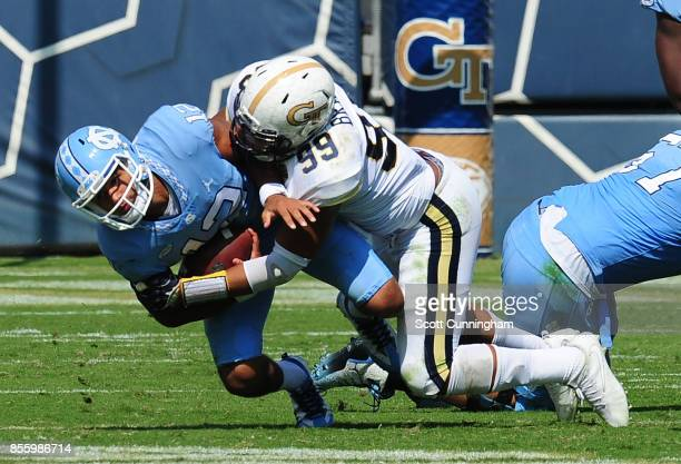 Chazz Surratt of the North Carolina Tar Heels is sacked by Desmond Branch of the Georgia Tech Yellow Jackets on September 30 2017 in Atlanta Georgia...