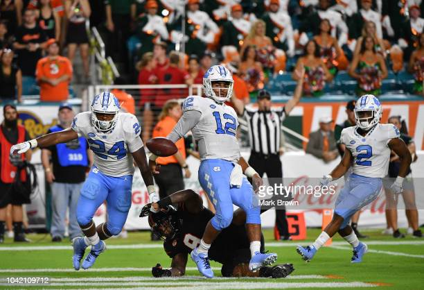 Chazz Surratt of the North Carolina Tar Heels scores a touchdown in the first quarter against the Miami Hurricanes at Hard Rock Stadium on September...