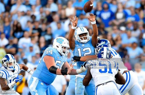 Chazz Surratt of the North Carolina Tar Heels throws an inteception against the Duke Blue Devils during fourth quarter oftheir game at Kenan Stadium...
