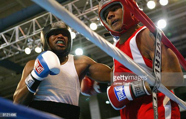 Chazz Witherspoon battles Charles Leverette during the United States Olympic Team Boxing Trials at Battle Arena on February 19 2004 in Tunica...