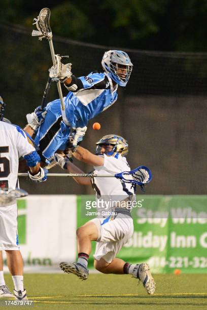 Chazz Woodson of the Ohio Machine attempts to score over goalie Adam Ghitelman of the Charlotte Hounds in the fourth period on July 27 2013 at Selby...