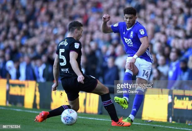 Che Adams of Birmingham beats James Chester of Aston Villa during the Sky Bet Championship match between Birmingham City and Aston Villa at St...