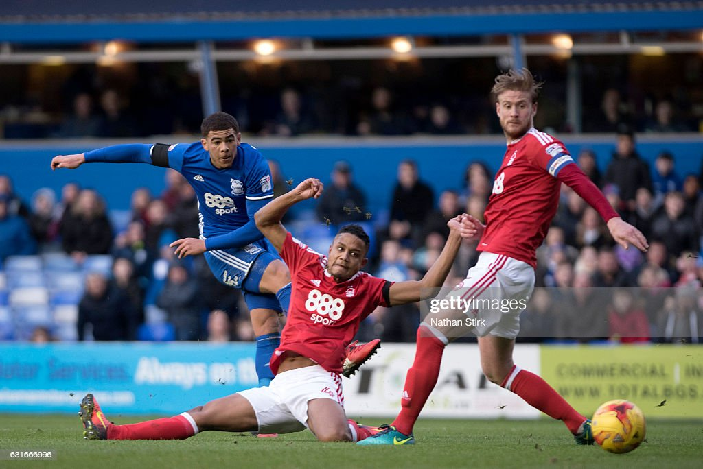 Che Adams of Birmingham City and Michael Mancienne of Nottingham Forest in action during the Sky Bet Championship match between Birmingham City and Nottingham Forest at St Andrews Stadium on January 14, 2017 in Birmingham, England