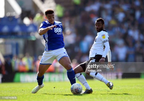 Che Adams of Birmingham City battles for possession with Ashley Cole of Derby County during the Sky Bet Championship match between Birmingham City...