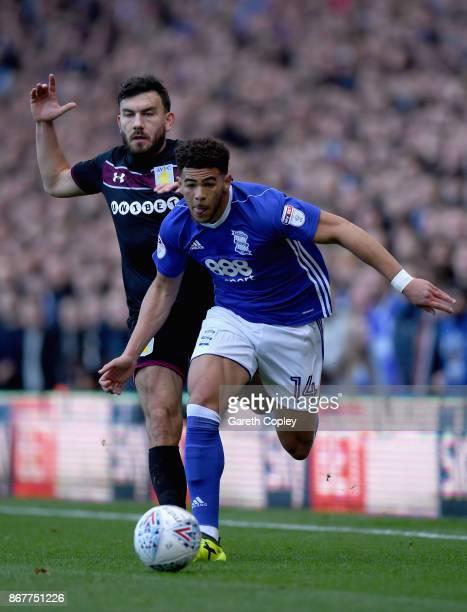 Che Adams of Birmingham City evades Robert Snodgrass of Aston Villa clash during the Sky Bet Championship match between Birmingham City and Aston...