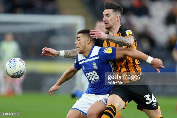 Che Adams of Birmingham City shields the ball from Liam Ridgewell of Hull City at KCOM Stadium on March 02 2019 in Hull England