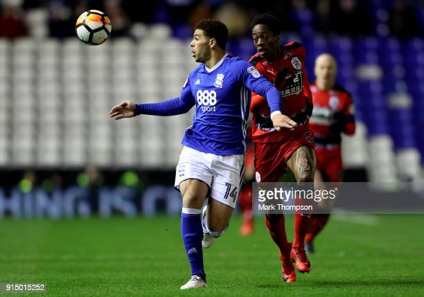 Che Adams of Birmingham is challenged by Terence Kongolo of Huddersfield Town during The Emirates FA Cup Fourth Round match between Birmingham City...