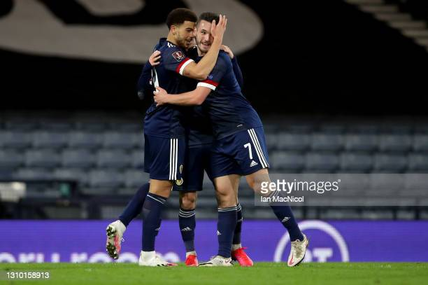 Che Adams of Scotland celebrates with teammate John McGinn after scoring their team's third goal during the FIFA World Cup 2022 Qatar qualifying...