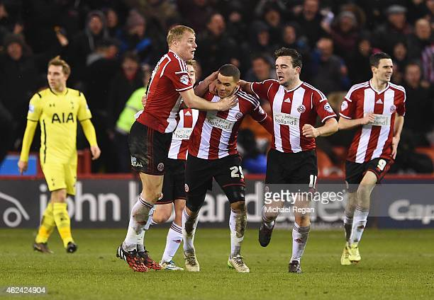 Che Adams of Sheffield United celebrates scoring his second goal with team mates during the Capital One Cup SemiFinal Second Leg match between...