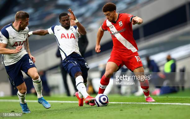 Che Adams of Southampton and Serge Aurier of Tottenham in action during the Premier League match between Tottenham Hotspur and Southampton at...