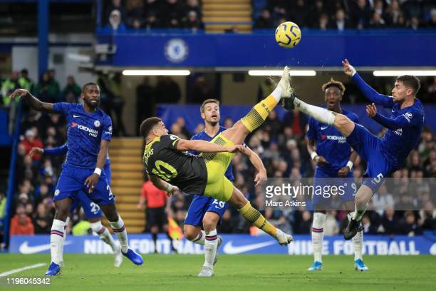 Che Adams of Southampton attempts a bicycle kick under pressure from Jorginho of Chelsea during the Premier League match between Chelsea FC and...