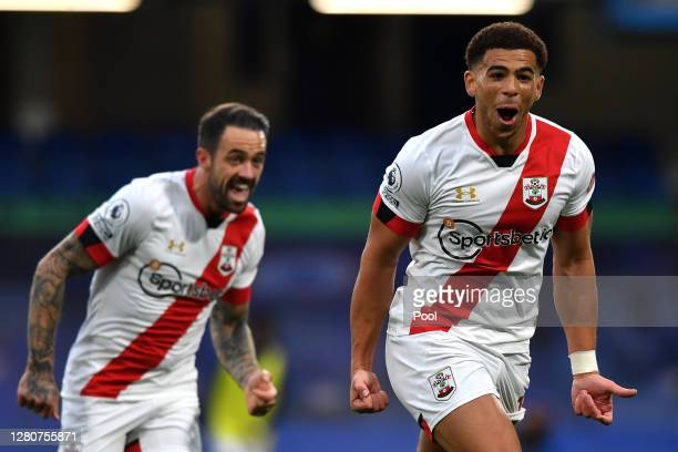 Che Adams of Southampton celebrates after scoring his sides second goal during the Premier League match between Chelsea and Southampton at Stamford...