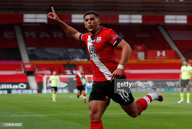 Che Adams of Southampton celebrates after scoring his team's first goal during the Premier League match between Southampton FC and Sheffield United...