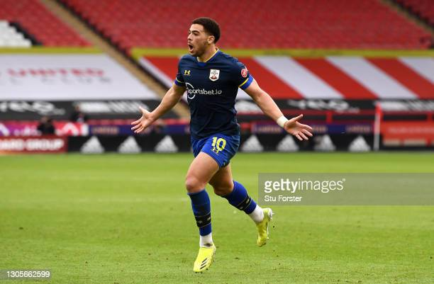 Che Adams of Southampton celebrates after scoring his team's second goal during the Premier League match between Sheffield United and Southampton at...