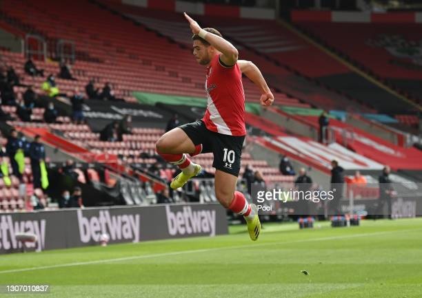 Che Adams of Southampton celebrates after scoring their side's first goal during the Premier League match between Southampton and Brighton & Hove...