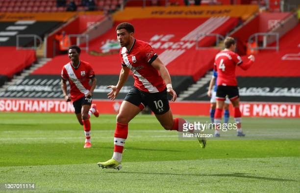 Che Adams of Southampton celebrates after scoring to make it 1-1 during the Premier League match between Southampton and Brighton & Hove Albion at St...