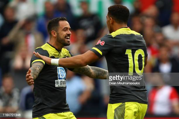 Che Adams of Southampton celebrates scoring his teams first goal of the game with Danny Ings during the pre season friendly match between Feyenoord...