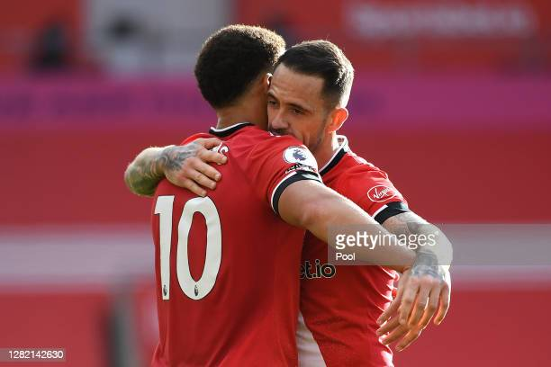 Che Adams of Southampton celebrates with team mate Danny Ings after scoring his sides second goal during the Premier League match between Southampton...