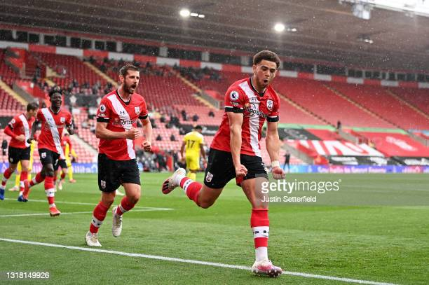 Che Adams of Southampton celebrates with team mate Jack Stephens after scoring their side's first goal during the Premier League match between...