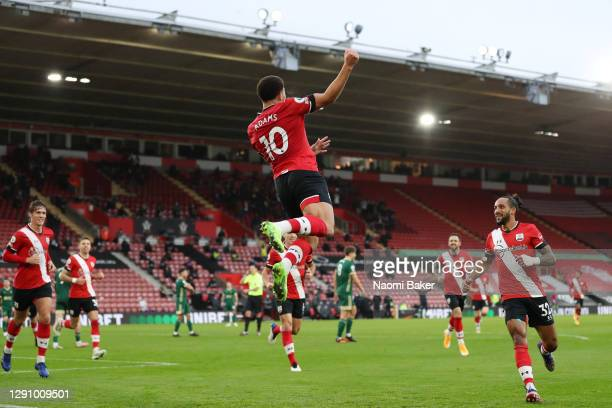 Che Adams of Southampton celebrates with teammates after scoring their team's first goal during the Premier League match between Southampton and...