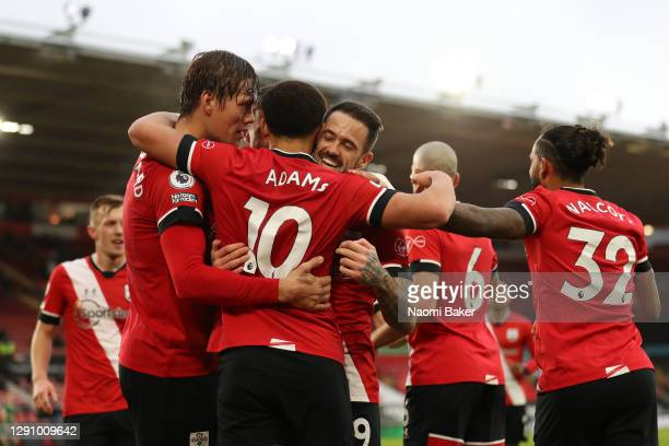 Che Adams of Southampton celebrates with teammates Jannik Vestergaard, Danny Ings and Theo Walcott after scoring their team's first goal during the...