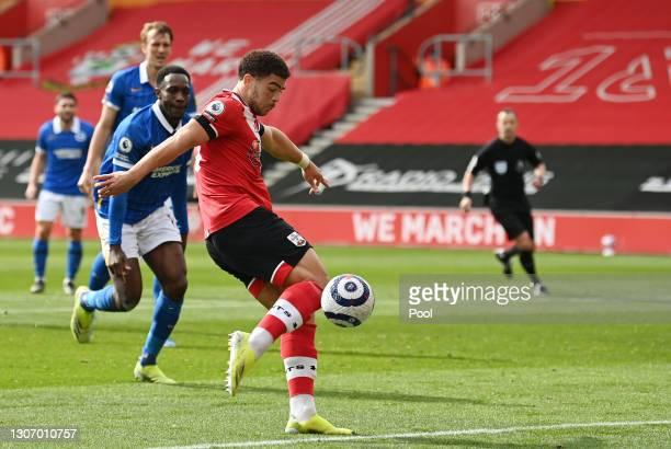 Che Adams of Southampton scores their side's first goal during the Premier League match between Southampton and Brighton & Hove Albion at St Mary's...