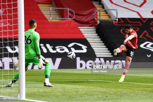 Che Adams of Southampton scores their side's first goal past Robert Sanchez of Brighton and Hove Albion during the Premier League match between...