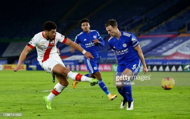 Che Adams of Southampton shoots at goal while challenged by Jonny Evans of Leicester City during the Premier League match between Leicester City and...