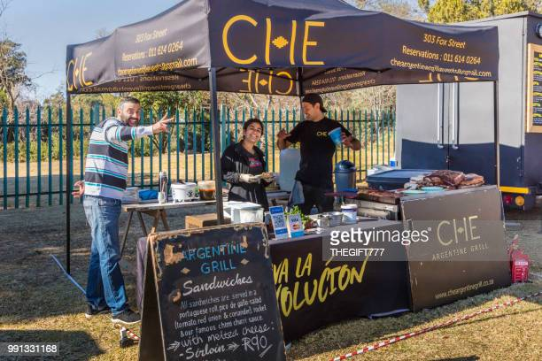 che argentine grill kiosk at the linden market - build grill stock photos and pictures